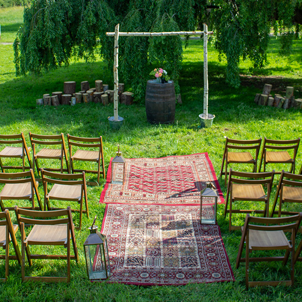 Outdoor wedding ceremony, rustic aisle