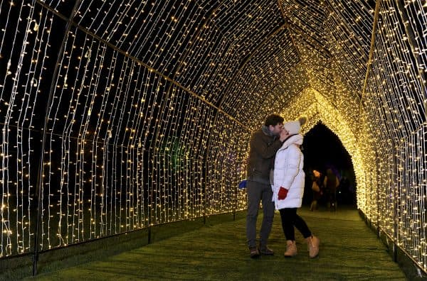 Tunnel of lights with couple kissing underneath